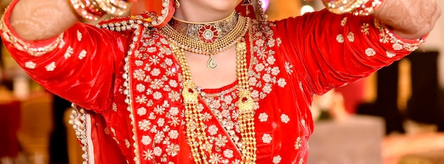 Pakistani indian bridal showing her wedding gold necklace in wedding