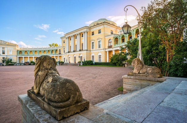 Palace in pavlovsk, lit by the autumn sun, and statues of lions on the stairs  in st. petersburg