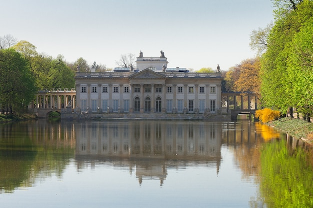 Palace over water in lazienki park, warsaw, poland