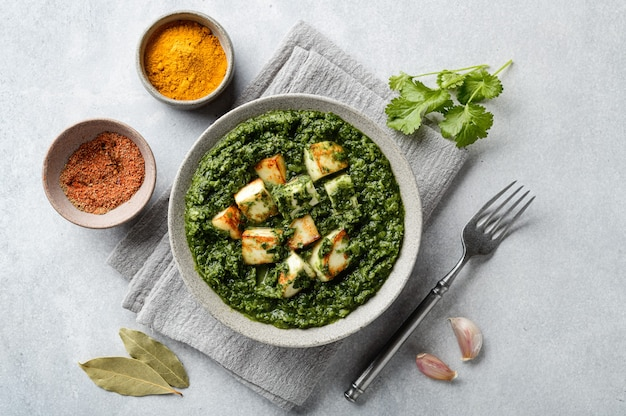 Palak paneer indian traditional food on concrete surface top view