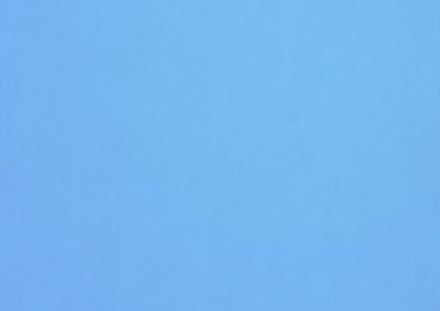 淡いブルーの紙のテクスチャの背景。きれいな空白の壁紙