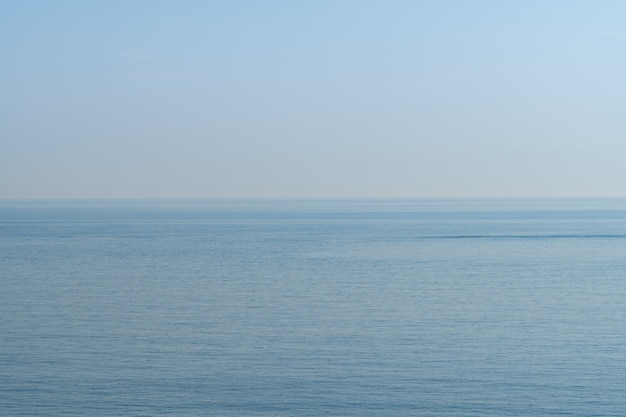 Pale blue sky and sea at seashore around suwolbong volcano, jeju, south korea.