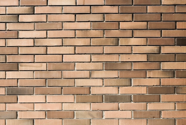 Pale brown wall bricks background texture