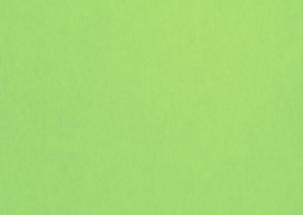 淡い緑の紙のテクスチャの背景。きれいな空白の壁紙