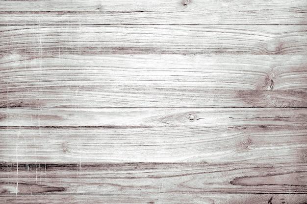 淡い素朴な木製の織り目加工のフローリングの背景