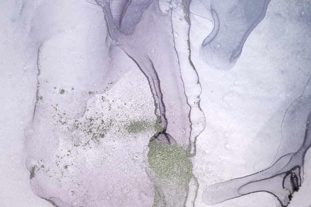 Pale transparent watercolor paint drops background.