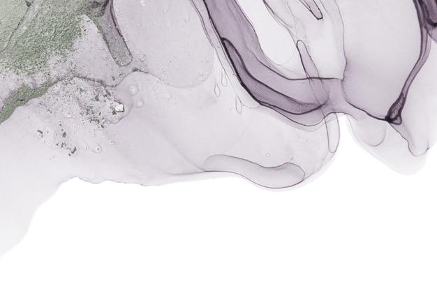 Pale transparent watercolor paint drops background