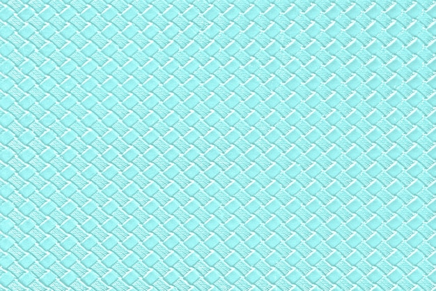 Pale turquoise leather background with imitation weave texture. glossy artificial leather structure.