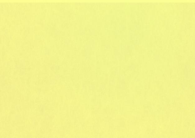 淡い黄色の紙のテクスチャの背景。きれいな空白
