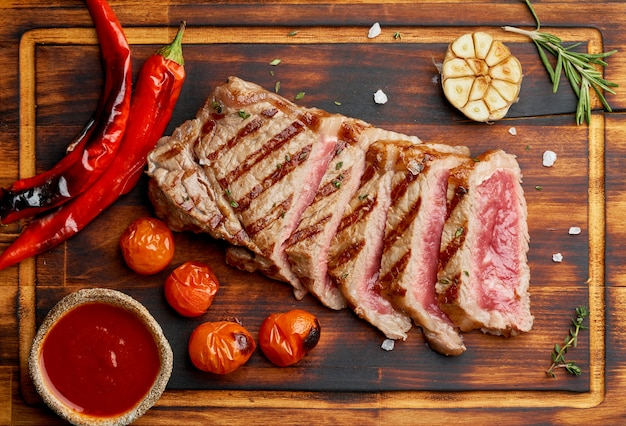 Paleo food recipe with grilled fried chopped piece of meat, papper, top view, close up