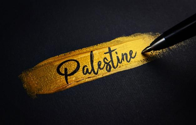 Palestine handwriting text on golden paint brush stroke