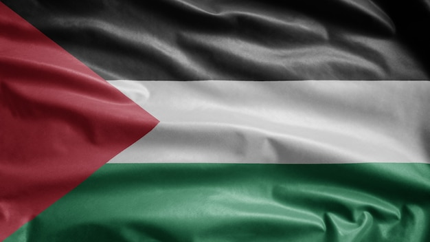 Palestinian flag waving in the wind. close up of palestine template blowing, soft and smooth silk.