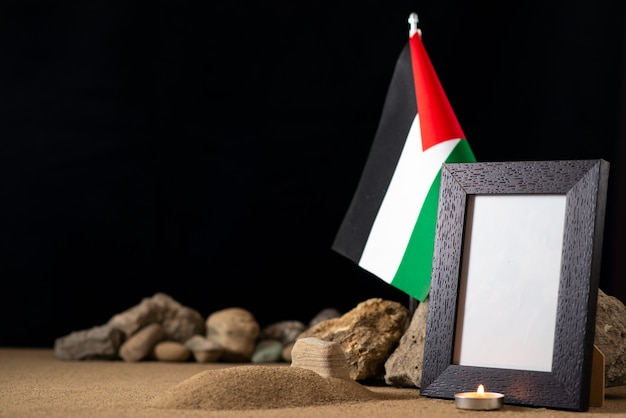 Palestinian flag with picture frame on dark surface