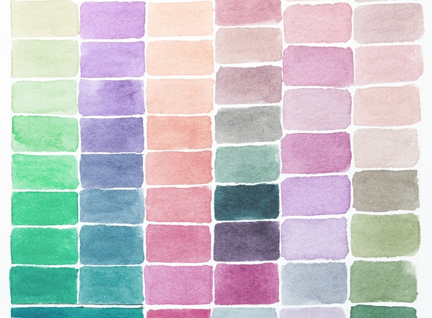 Palette of shades watercolors different colors painted on white paper. sample of paint spectrum. drawing pattern and artist background.