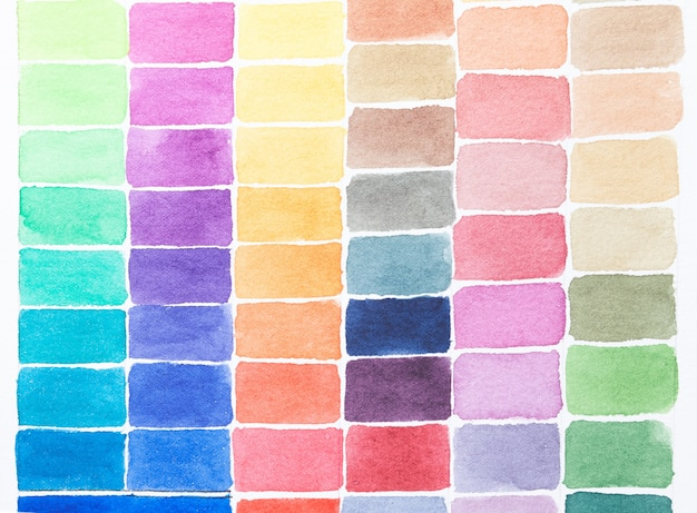 Palette of shades watercolors different colors painted on white paper