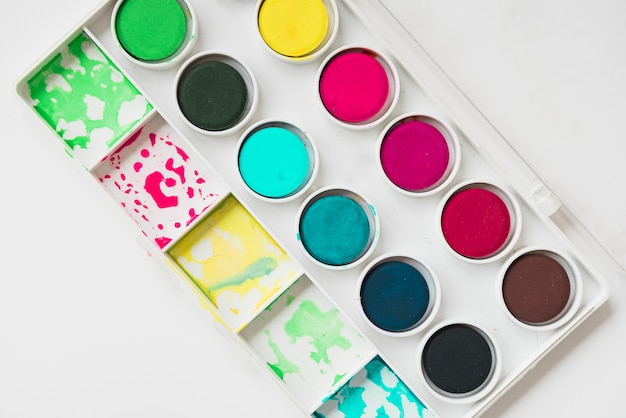 Palette of watercolor paint against white background