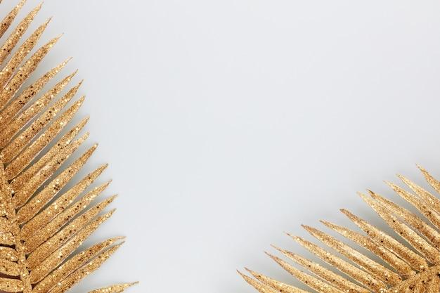 Palm gold leaf on blue background