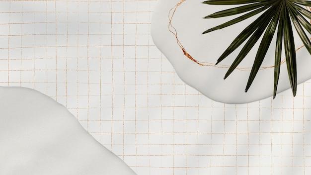 Palm leaf on grid background