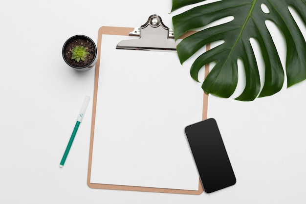 Palm leaves and a clip board with free space for text.