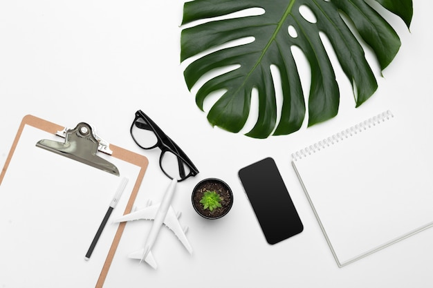 Palm leaves and a paper notebook with free space for text.