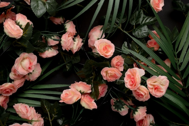 Palm leaves with pink flowers background