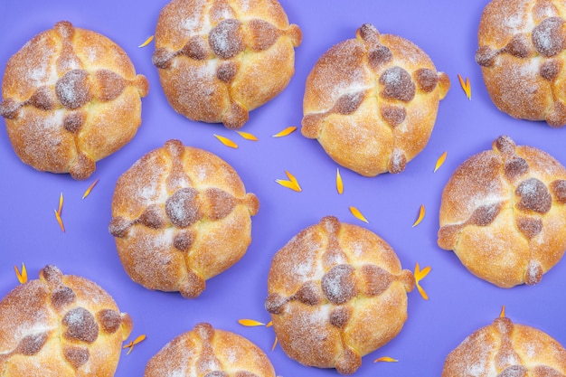 Pan de muerto on blue background, typical mexican food. day of the dead celebration. copy space. top view.