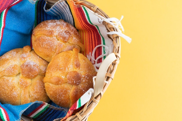 Pan de muerto in a wooden basket. day of the dead. mexican holiday. copy space. top view.