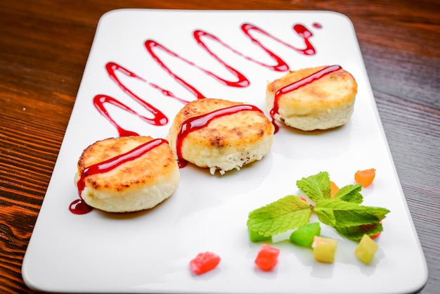 Pan-fried cottage cheese patties with strawberry jam