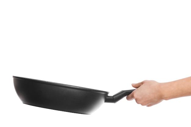白い壁に手の鍋