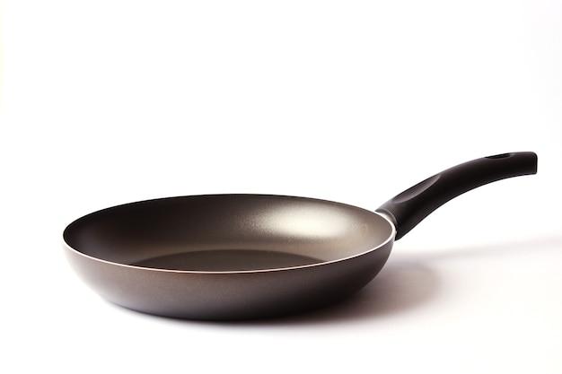 白で隔離の鍋。焦げ付き防止コーティング。料理する。台所用品。高品質の写真