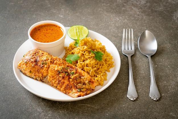 Pan seared salmon tandoori with masala rice. muslim food style