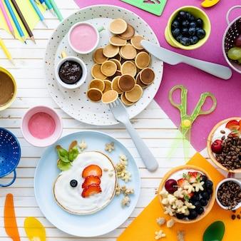 Pancake party, kids food with fresh berries and yogurt