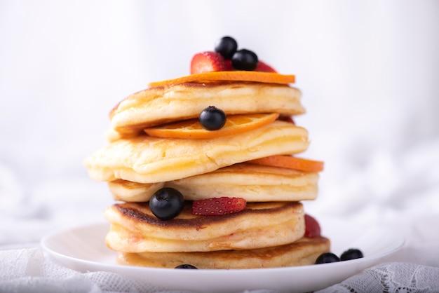 Pancake stack with berries fruit