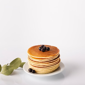 Pancake tower on plate with blueberries