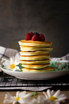 Pancake tower with forest fruits