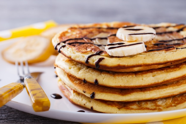 Pancake with banana in chocolate glaze