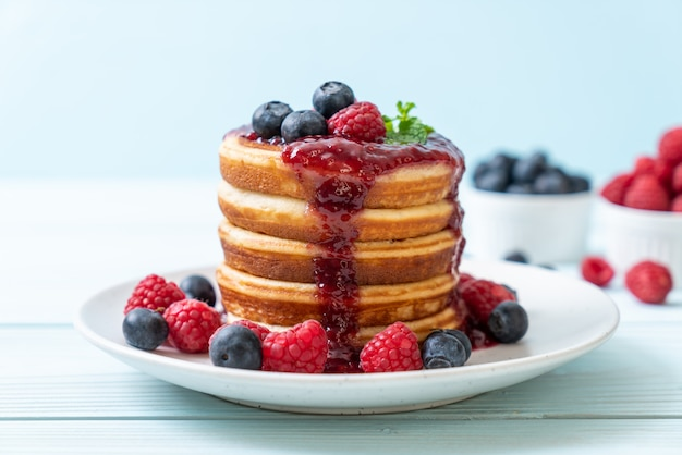 Pancake with fresh raspberries and blueberries