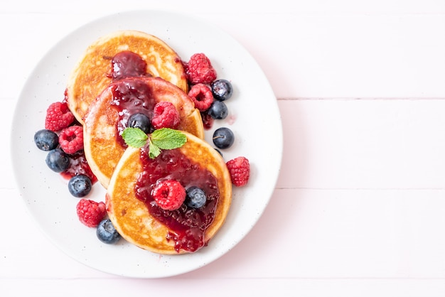 Pancake with fresh raspberries and blueberries