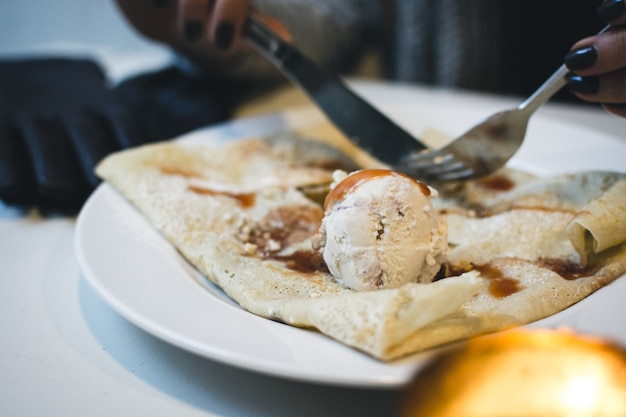 Pancake with ice cream and caramel topping