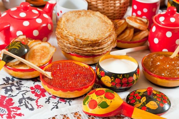 Pancake with red caviar