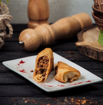Pancake wrap with minced meat and tomato mix