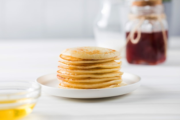 The pancakes are stacked in a plate breakfast concept copy space