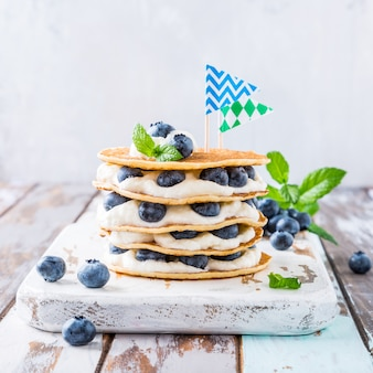 Pancakes cake with yogurt and blueberries