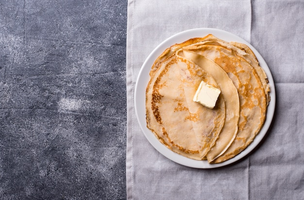 Pancakes crepes on dark background