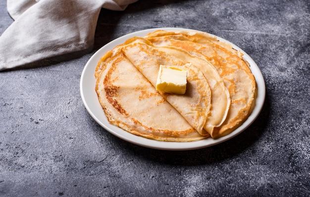 Pancakes crepes on dark