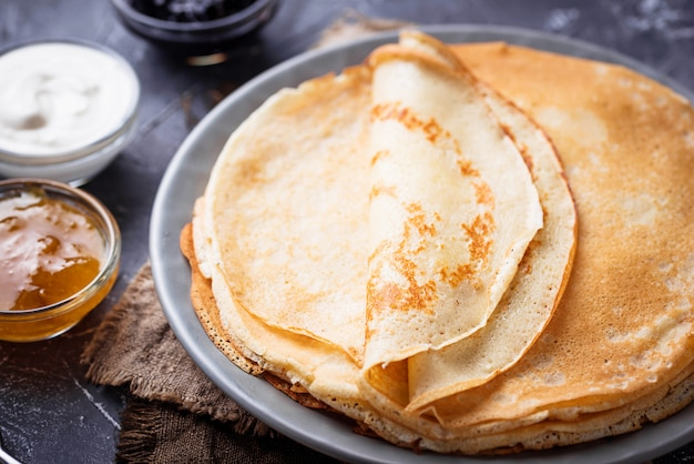 Pancakes crepes with different jam and cream