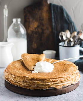 Pancakes crepes with sour cream russian traditional pancake week carnival