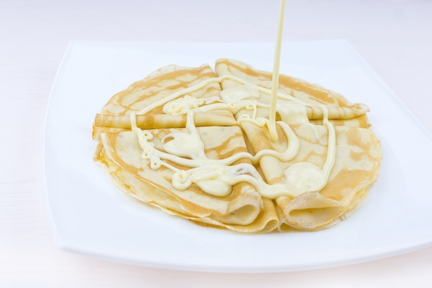Pancakes drenched with condensed milk