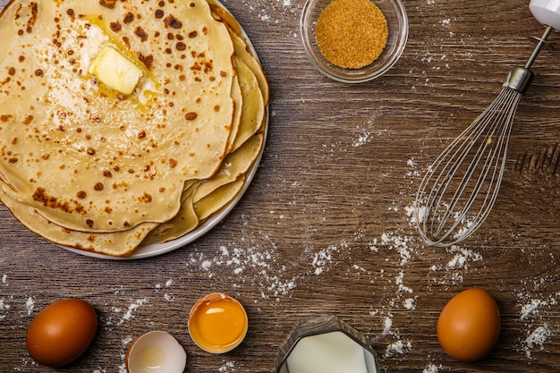 Pancakes on table with flour