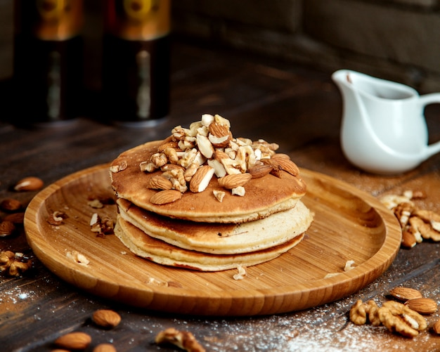 Pancakes topped with mixed nuts